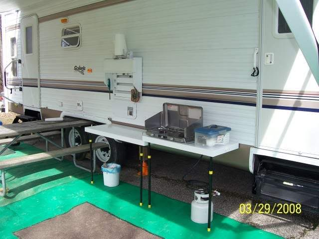 He Built An Outdoor Kitchen That Mounts To The Side Of The Camper