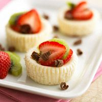 White Chocolate Mini Cheesecakes. made with vanilla wafers, reduced fat cream cheese, fat-free cream cheese, white chocolate, sugar, milk, vanilla, egg white & strawberries!