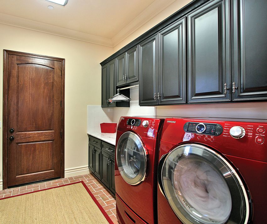 landry room with red washer and dryer