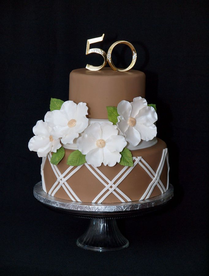 50th Anniversary cake. Cake design inspired by SugarCreations.  Inside is a chocolate sponge with buttercream and choc ganache. Yum!