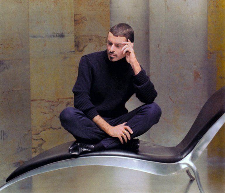 George Michael on modern chair.