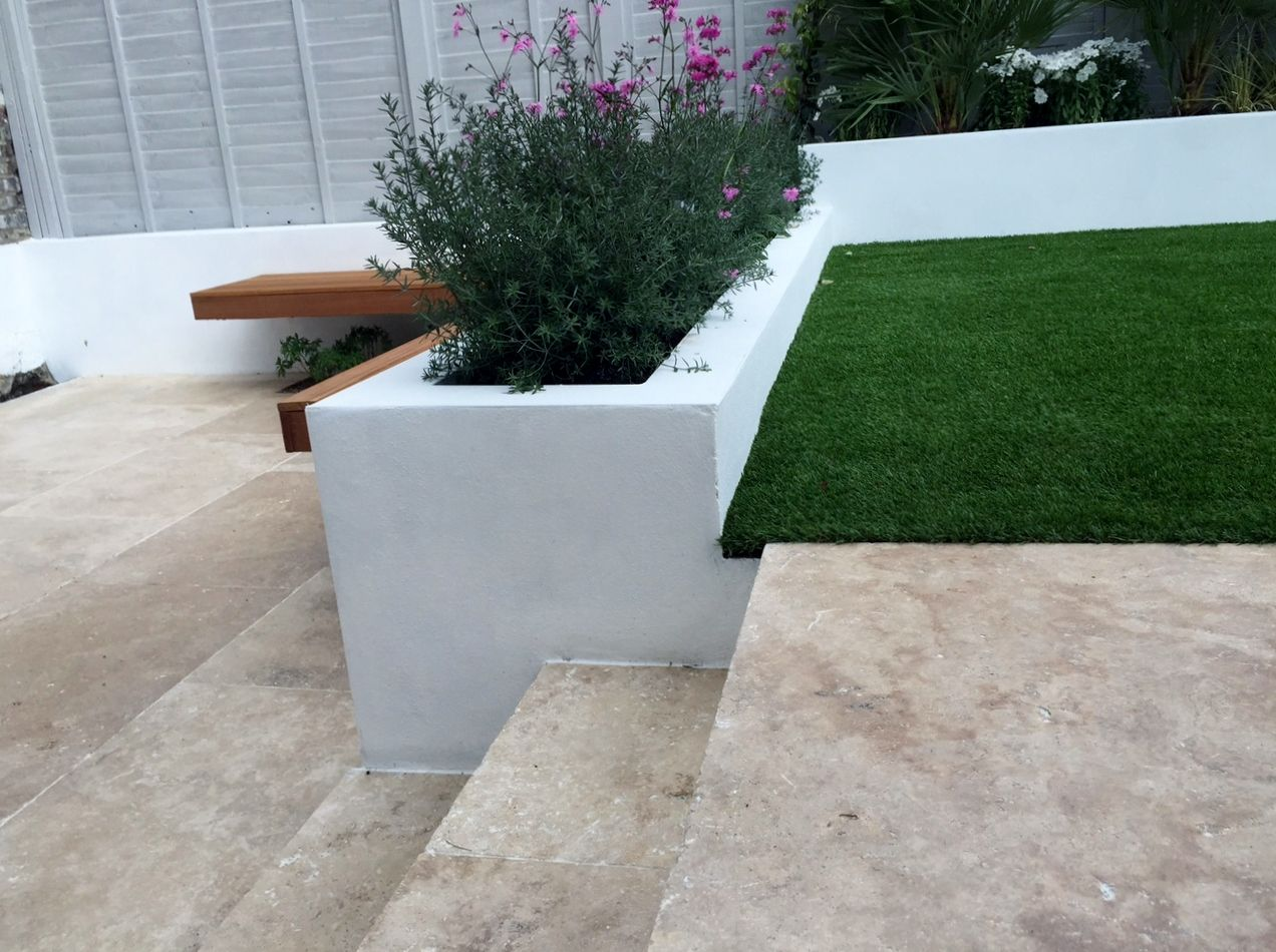 travertine garden steps and raised beds flaoting bench garden