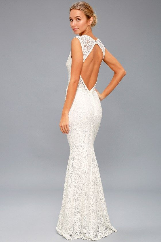 856ce376a19 Start your happily ever after in the Ceci White Lace Backless Maxi Dress!  Stunning floral lace tops a white liner as it shapes a plunging V-neck