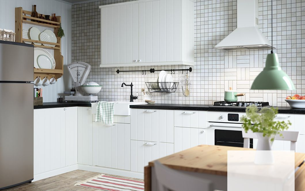 Black And White Country Kitchen an off-white country kitchen with black worktops. combined with