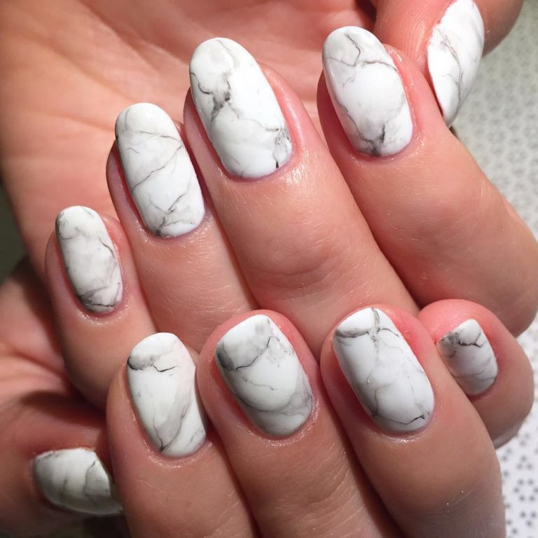 Marble Matte Instead of creating tie-dyed nails in bright neon ...