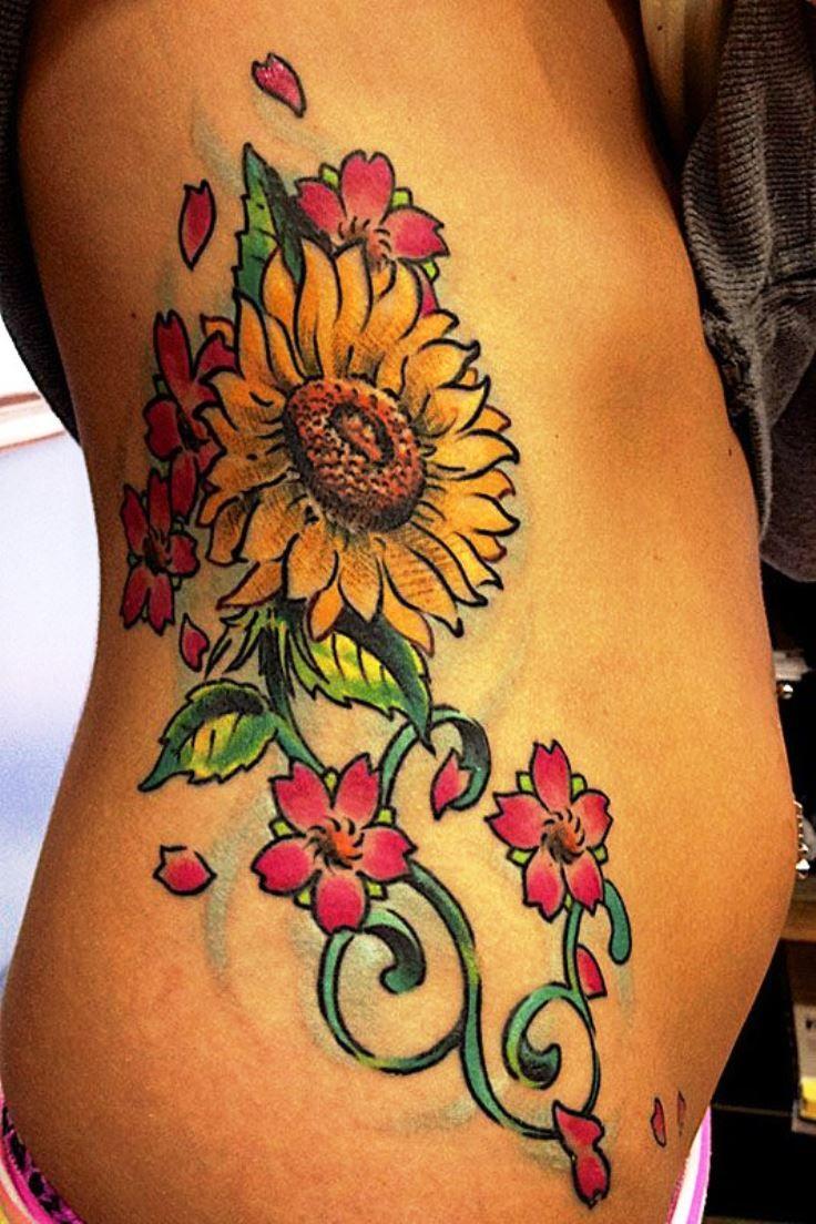 Great cover up tattoo ideas sunflower tattoo on side  great tats  pinterest  tattoo tatting