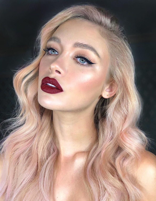 Eyeliner and dark red lipstick makeup look