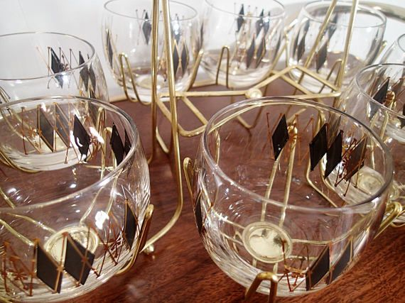 Beautiful Vintage Barware Set Includes 8 Diamond In Black Diamond Harliquin Design  With An Overlay Of Gold Diamond Outlines.