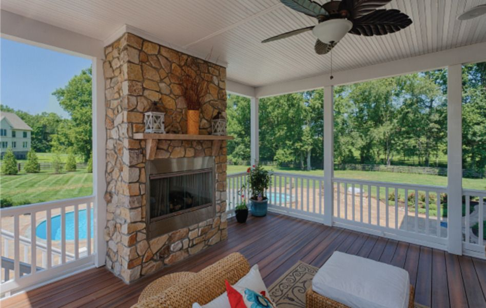 Screen Porch Was Built Off The Kitchen Area With Stone Fireplace And Views To Outdoor Kitchen And Pool Space Custom Home Builders Home Builders Custom Homes