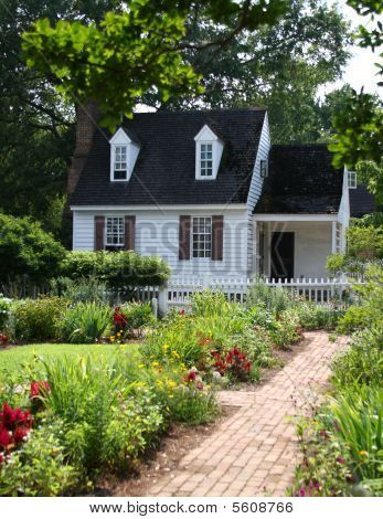 Picture Or Photo Of Colonial Garden With White Washed Home And Picket Fence In Colonial Williamsburg V Colonial Exterior Backyard Guest Houses