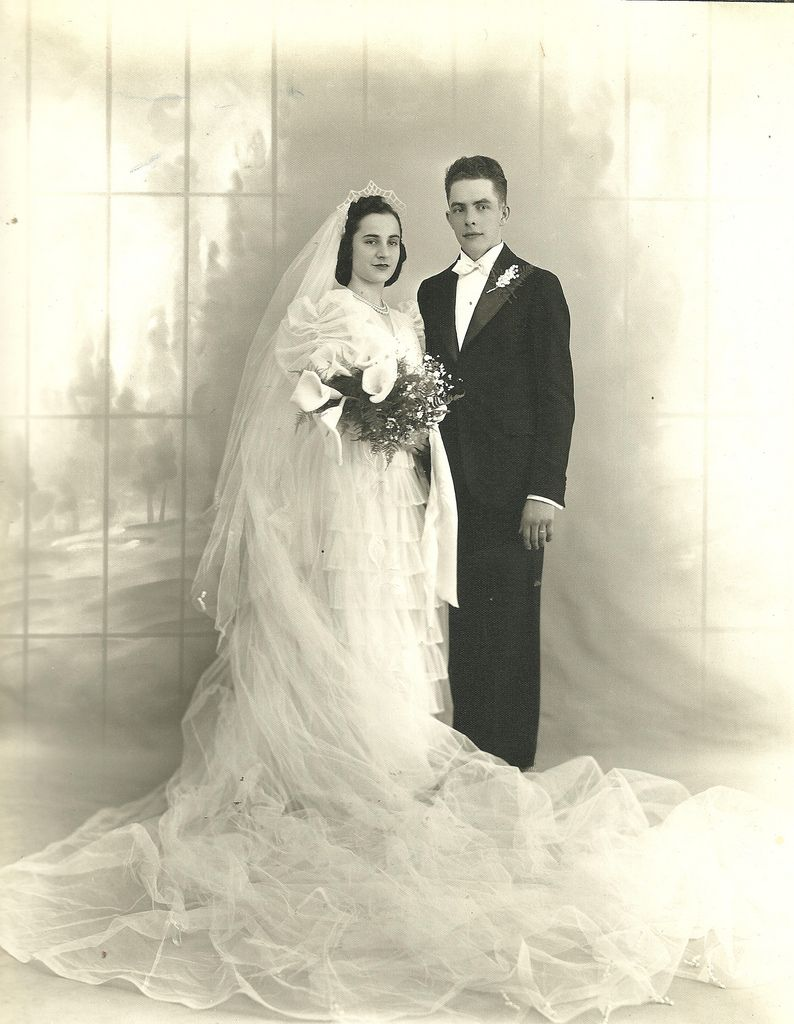 Detroit wedding, c.1930s. Can anyone identify any of the people in this photograph? Please add comments and notes.  The images in this set were acquired at the Detroit estate sale of a woman who ran a floral shop on Chene Street for many years. The photos may have been connected with her business, and many of them were produced by Hoffman and Smart Set studios. We would like to use these images in the ongoing Chene Street History Project, but need more information first.