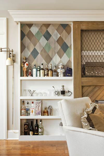 Built Out Into The Room Just One Bottle Deep, This Bookcase Bar Features A  Sliding