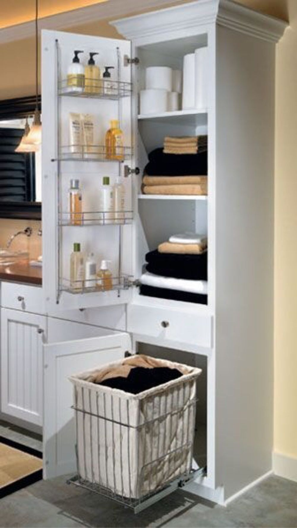 Bathroom cabinet with built in laundry hamper - Linen Closet With Chrome Shelving Rack On Door And A Removable Pullout Hamper Laundry Basketslaundry Roomlaundry Cabinetslaundry