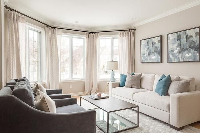 10 Welcoming Living Room Features Bay Windows Dressed In Cream Curtains Complementing Cream Cream Sofa Living Room Cream Living Rooms Cream Couch Living Room