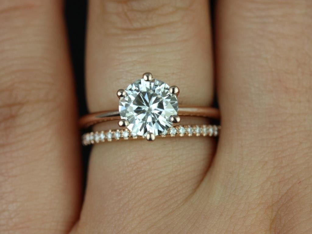 this is it. plain thin engagement band, solitaire round diamond