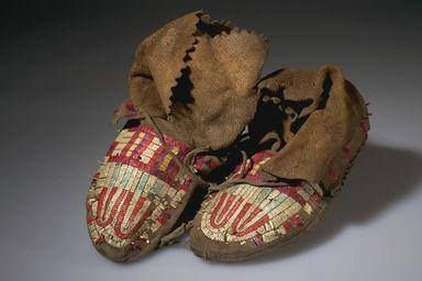 MOCCASINS (PAIR), MAN'S  NORTH AMERICAN ETHNOGRAPHIC COLLECTION  Catalog No: 50.1/ 5810 AB Field No: B167  Culture: CREE, PLAINS  Locale: ALB, HOBBEMA  Country: CANADA  Material: HIDE, QUILL, PIGMENT, THREAD, SINEW