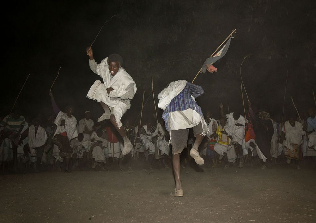 https://flic.kr/p/biUCiH   Gadaa ceremony dances - Ethiopia   Every eight years under a full moon, a tribe of Karrayyu priests gather in the Methara region, south of Addis Abeba, Ethiopia, for a ceremony to transfer power, this ceremony is named Gada. Five families share and govern the power.  In two days, 10,000 people come, mainly by foot to help with the running of the ceremony. Absolutely no tourists are allowed in the proximity. After weeks of negotiation with the tribe's leader, I…