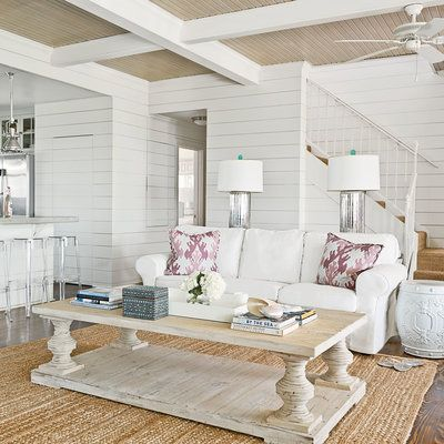 """""""We skipped anything too formal,"""" Elizabeth Munger Stiver says of this Galveston Bay, Texas, living room that called for a complete redesign. She and design partner Amy Munger brought in pine flooring and statement-making shiplap walls to add warmth."""