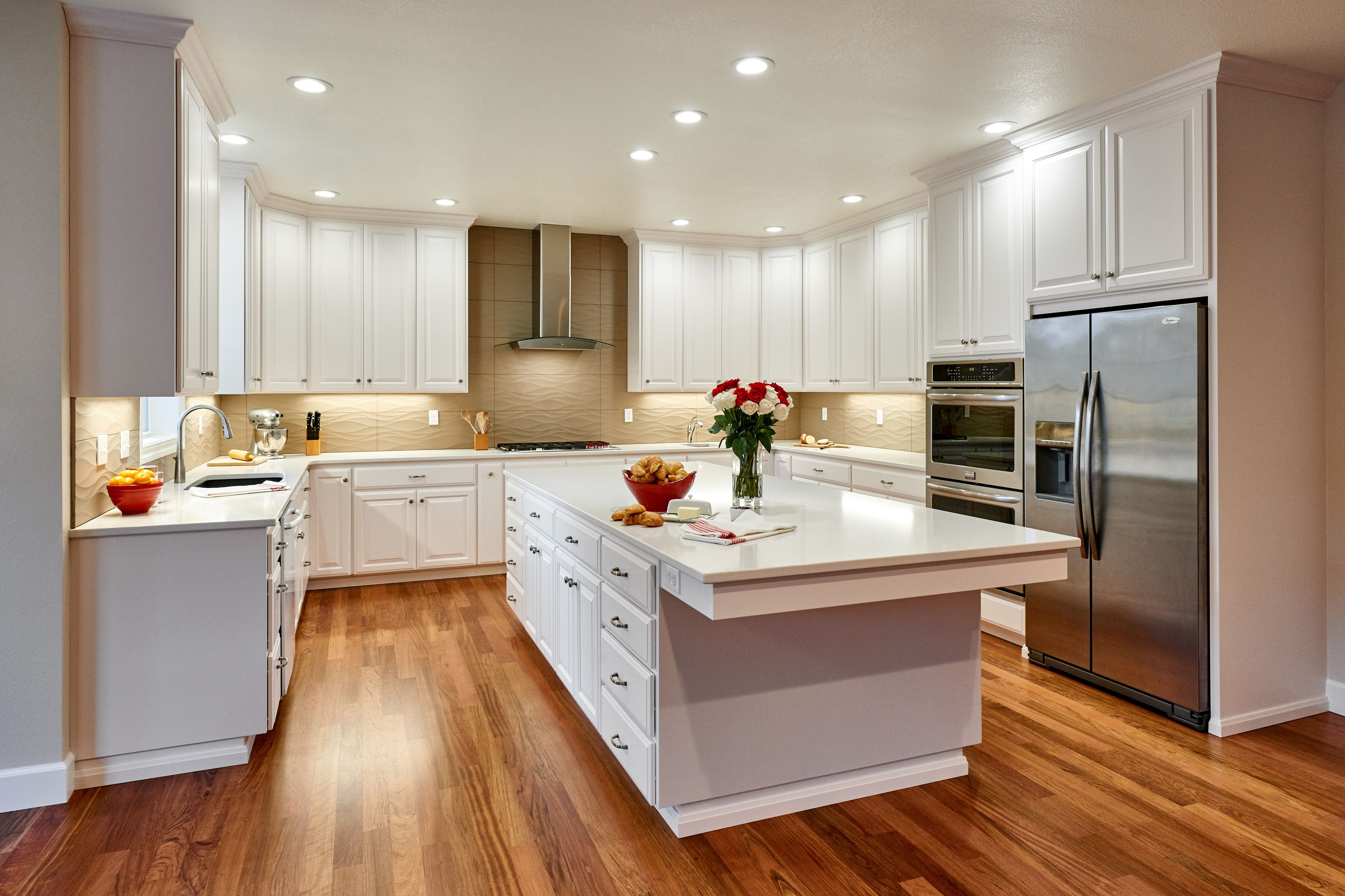 White Custom Cabinets And White Silestone Countertops In The New Kitchen Create The Bright Clean Feeling The Cli Kitchen Wood Floors Wide Plank Kitchen Design