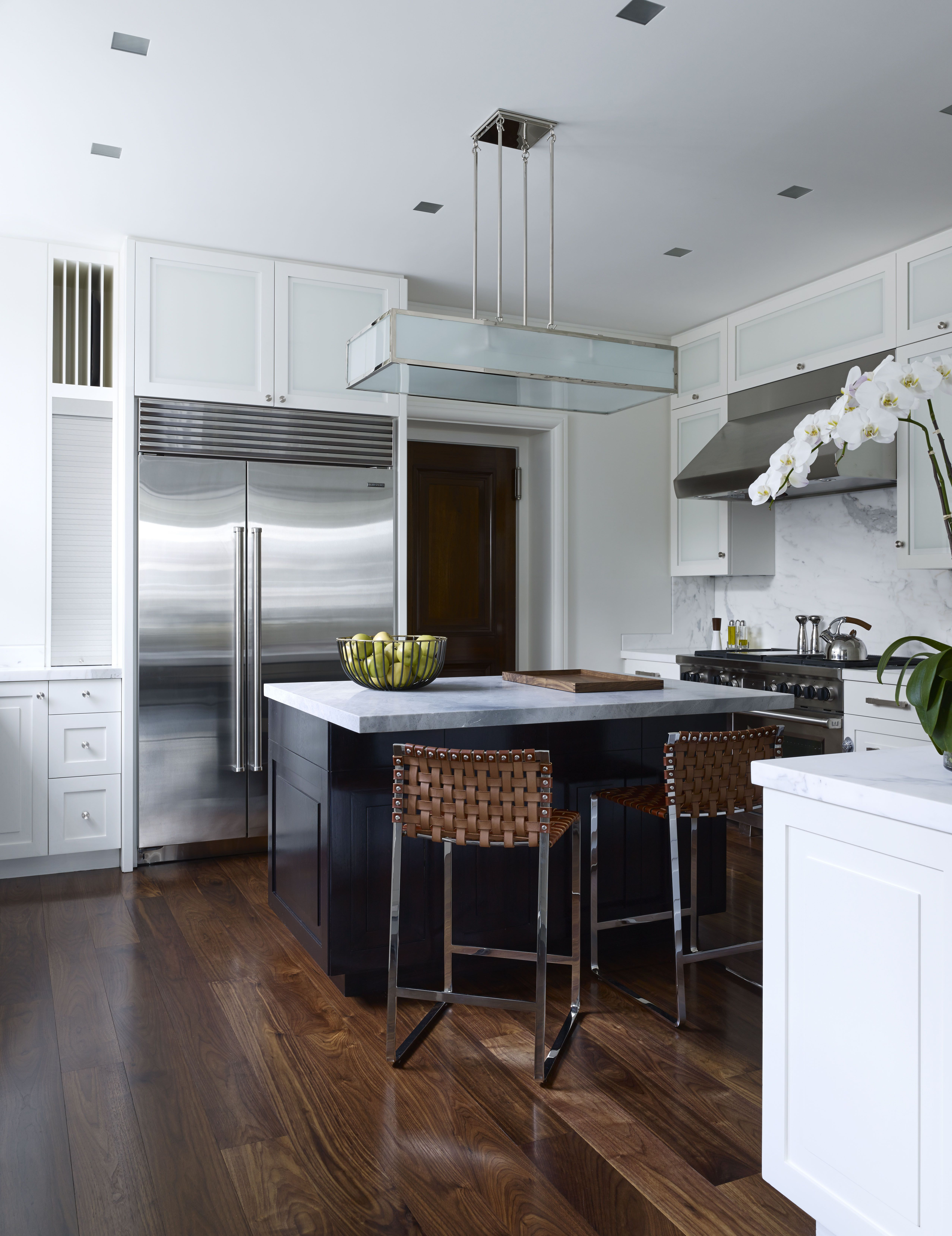 A functional kitchen serves as a family gathering space with woven