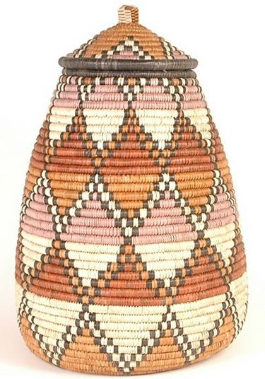 i love these african baskets. my favorites are made in kwazulu natal, south africa. the colors are so beautiful, and are achieved with natural dyes! i would love a bunch of them on a table.