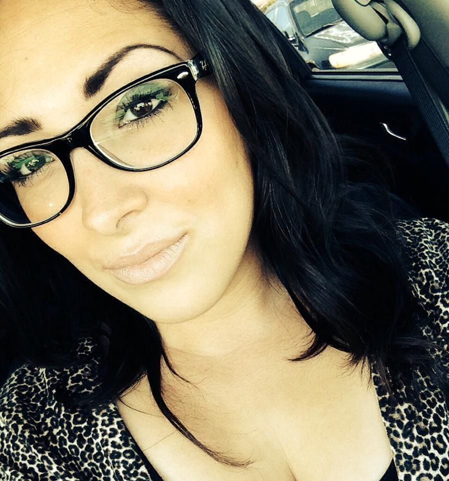 My friend Beatriz showing off her sexy makeup and glasses