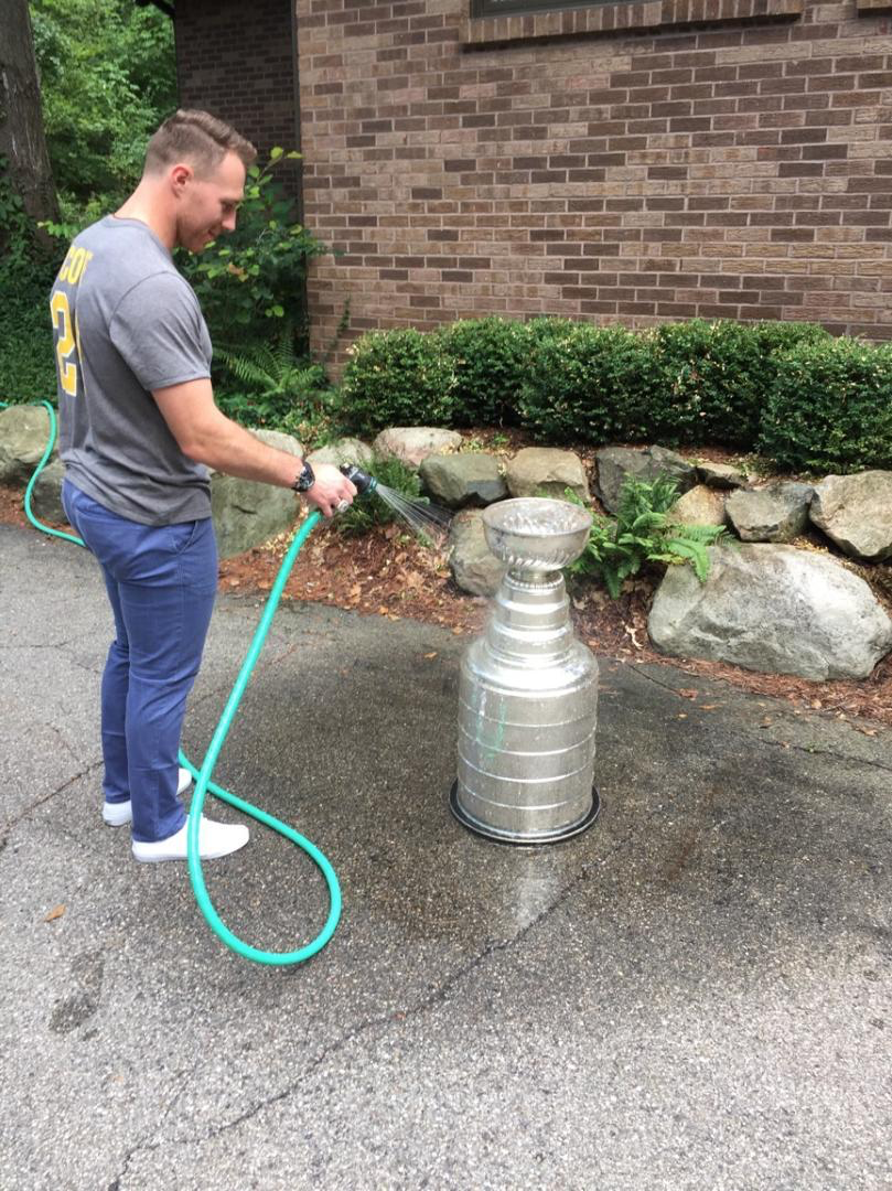 Ian Cole cleaning up the Stanley Cup, 2017.