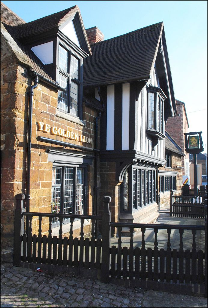 This is one of Wellingborough's oldest buildings, and possesses a genuine minstrel's gallery. It was constructed as a house in 1540 and it displays a fine combination of limestone and ironstone lines and a stout timber-framed bay which projects from the left side of the main entrance. It was modified during the 17th century and in 1830 it became an inn. It is now known as the Golden Lion.  This photo seems to be getting a lot of visitors recently. I'm intrigued to know why. Can an...