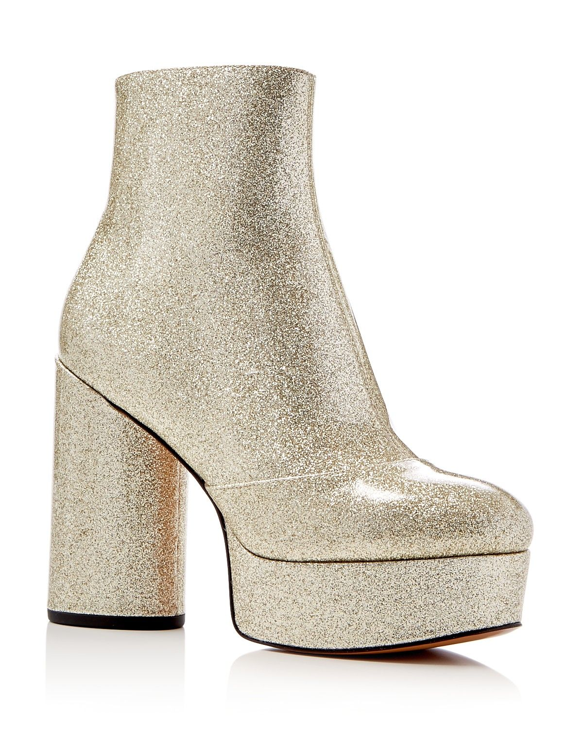 87cd954a9 Marc Jacob s platform booties step straight out of the  70s glam-rock era  in a glittering patent leather finish.