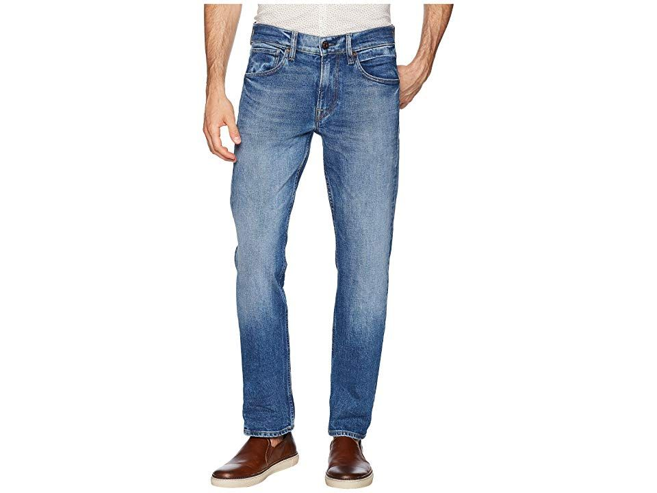 Hudson Byron Straight Zip in Verdugo (Verdugo) Men's Jeans. These Hudson jeans are the perfect fusion of style and comfort. The Byron sits at the waist  with a classic straight-leg fit. Verdugo is a faded  light indigo wash  cut from a medium weight  comfort stretch denim. Pieced back patch pockets feature a reverse triangle stitch. Five-pocket design. Belt loop waistband. Zipper fly and button closure. 99% cotton  1% elastane