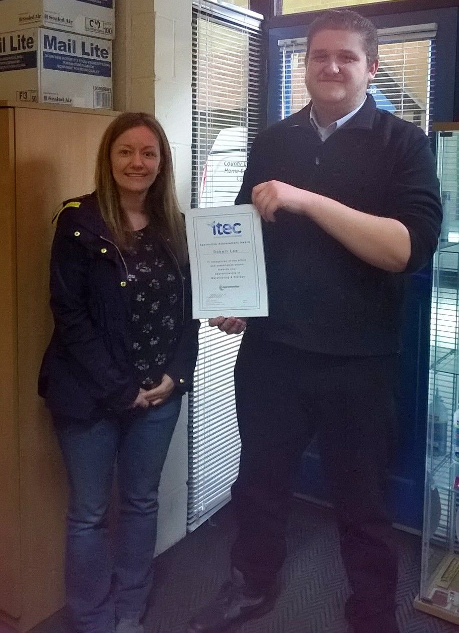 """Apprentice Robert Lee receives Apprenticeship Achievement Award from line manager Amanda Braybrook at Spennymoor based Multibond Solutions. Robert's commitment to his work and warehousing Apprenticeship was identified for progression into an office role and an Advanced Apprenticeship in Business Administration.  Robert acknowledges his apprenticeship have given him focus and increased confidence, openly admitting if he'd followed the college or uni route, he could well have """"gone off the…"""