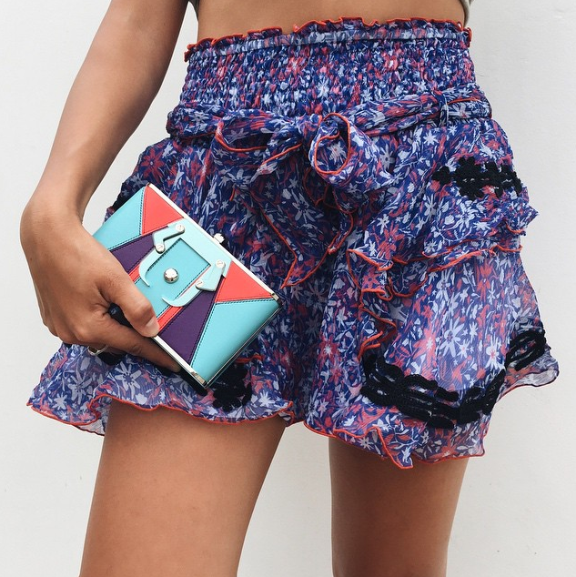 New at #ElodieK- this Poupette St. Barth mini skirt. Mix up your summer florals with our Paula Cademartori clutch!