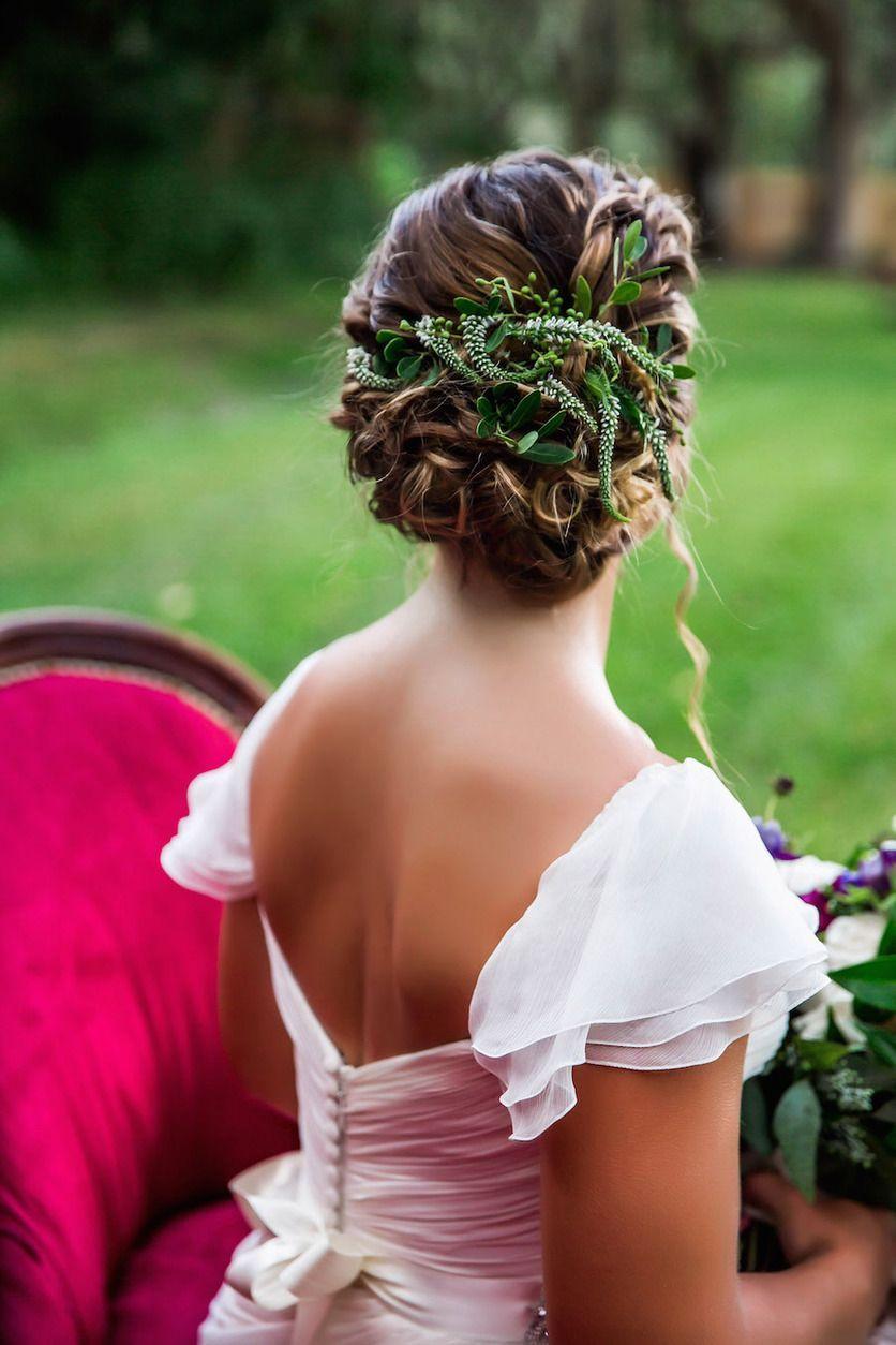Wedding hair braided updo with greenery amsale wedding dress from
