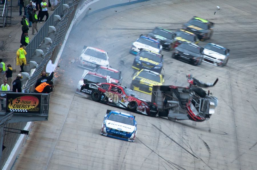 JoeyLogano (20) bounces off the wall and crashes into