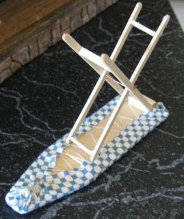 how to: ironing board Steps: 8 popsicle sticks, pece of cardboard, and fabric! That is all u need!
