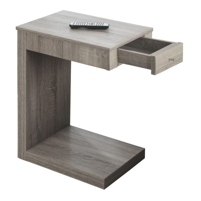 This modern snack table is the perfect combination of style and functionality. Finished in a bright white with contrasting brushed silver drawer pull, this robust looking piece will suit any decor. A front drawer provides hidden storage for mobile devices, remote controls or accessories, while the top is the ideal surface space to hold your drinks, snacks or even meals. Lounging on the couch has never been more convenient!