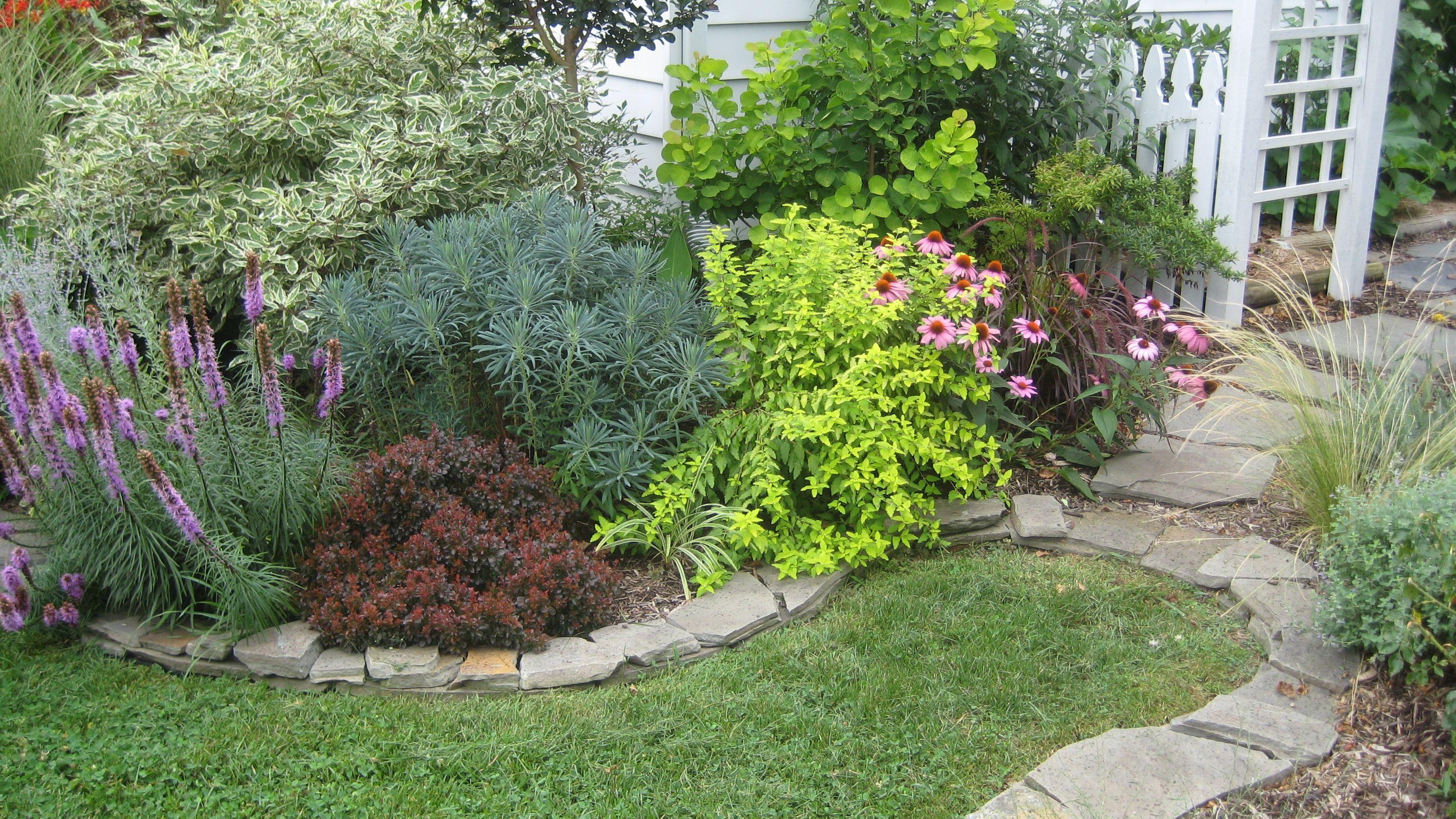 Dry stack stone wall edging garden design edging for Rock flower garden ideas