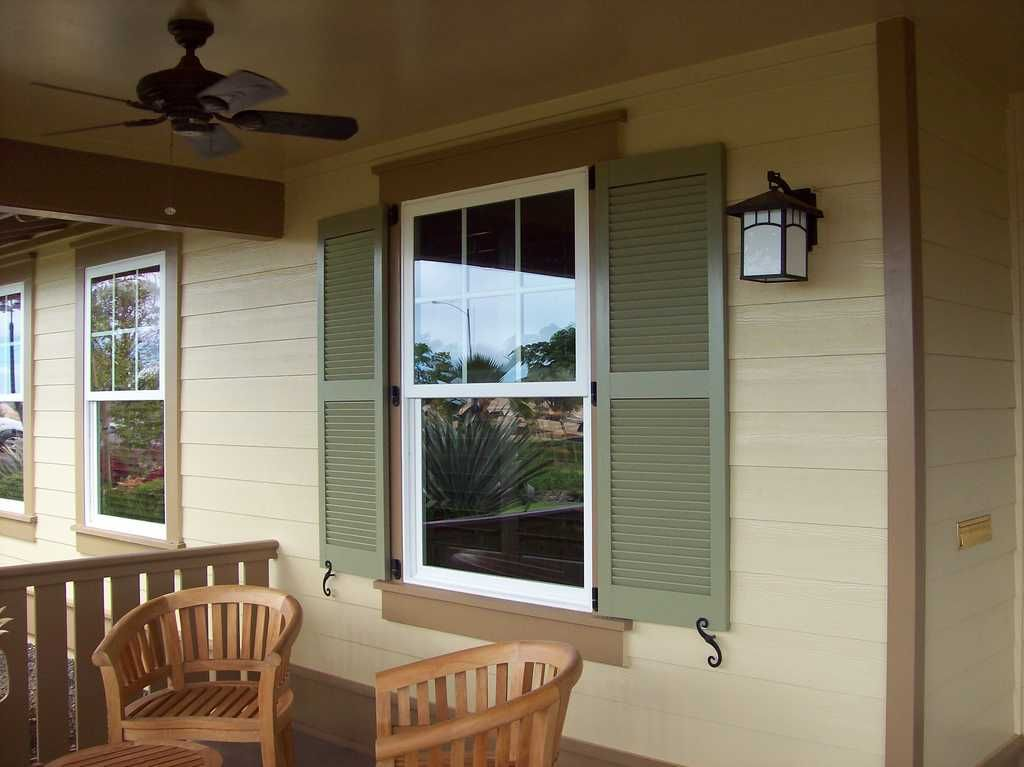 These Louvered Exterior Shutters Add A Classic Traditional Look To This Home Our Louvered Exterio Shutters Exterior Windows Exterior Interior Window Shutters