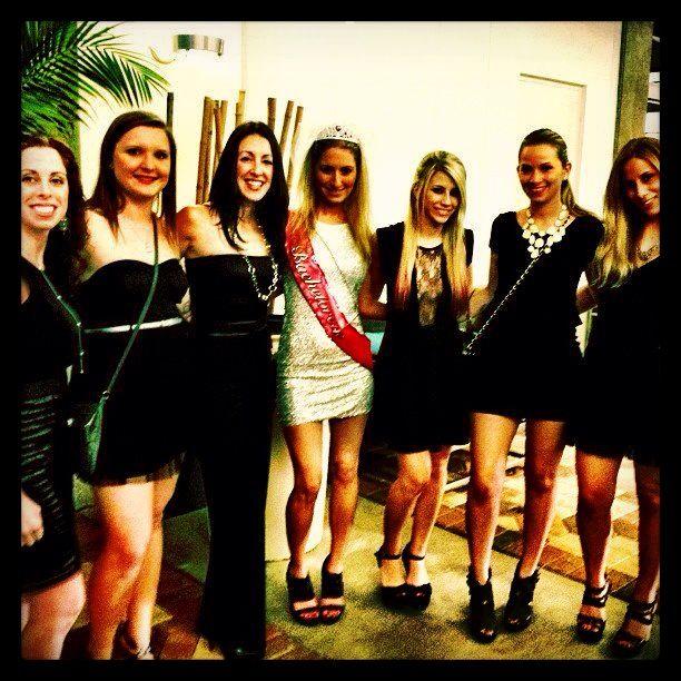 bachelorette party idea bride wears white and bridesmaids wear black