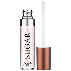 This clear gloss contains mango butter to soften lips and hyaluronic acid to make them look fuller.  Sephora: Fresh : Sugar Shine Lip Treatment