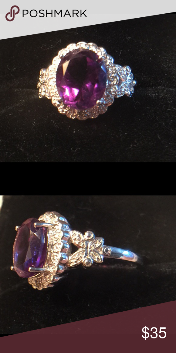 .925 Sterling 2.92 ct Amethyst Ring .925 Sterling silver and 18 karat gold overlay. 2.91 genuine amethyst and genuine diamond weight of ring is 4.8 g. Jewelry Rings