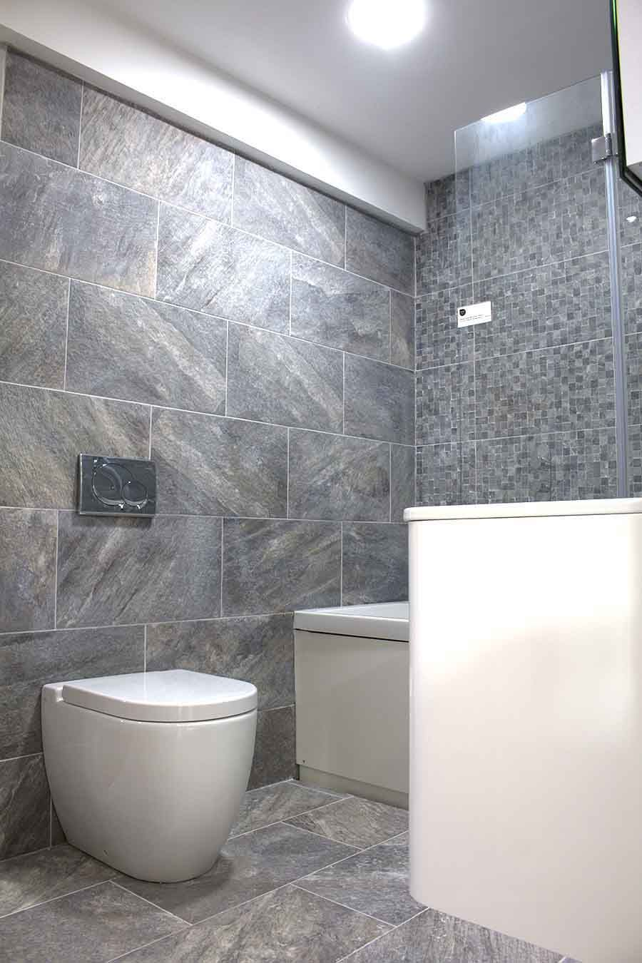 A modern bathroom display with stone effect porcelain tiles and