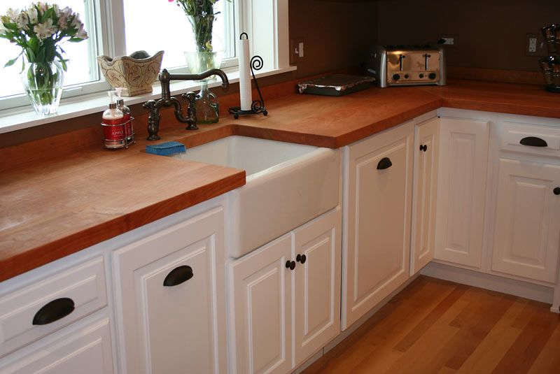 white painted cabinets, with those dark and copper knobs and a