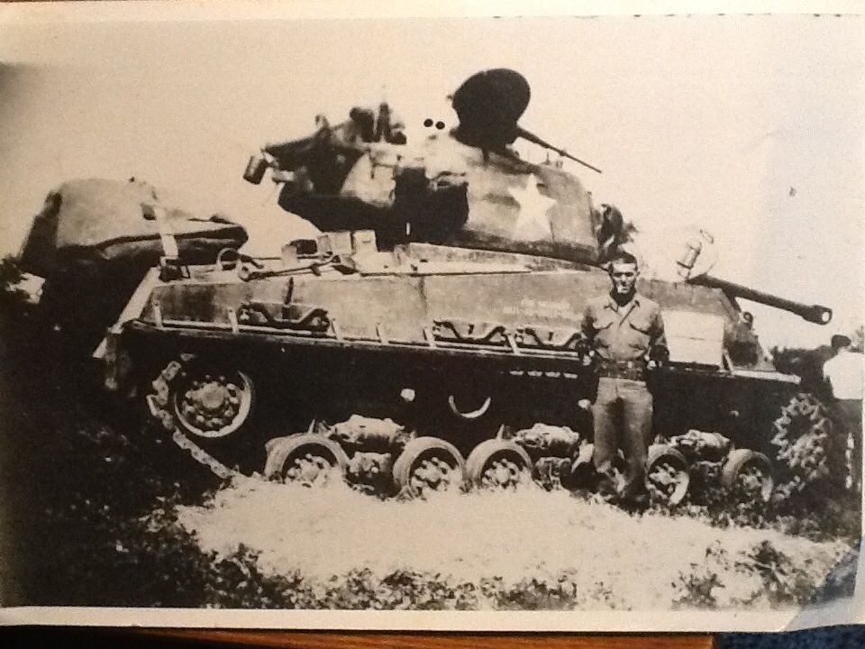 """Pic of my Dad, post BoB in Germany, 4th AD, 35th tank Battalion Happiness is a Lucky Strike and a 1911/45ACP each hand! Note indention next to turret star, he said it was from a Tiger 88 grazing """"miss"""""""