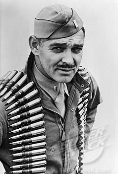 """Clark Gable (1901-1960) Major US Army Air Corps 1942-44 WW II. """"Although beyond draft age, Clark Gable enlisted as a private. Assigned to OCS he excelled and received a commission. He flew five combat mission as an observer/gunner in a B-17earning a Distinguished Flying Cross and an Air Medal. On his fourth mission, a 20mm shell cut the heel from his boot. His discharge was signed by Captain Ronald Reagan."""""""