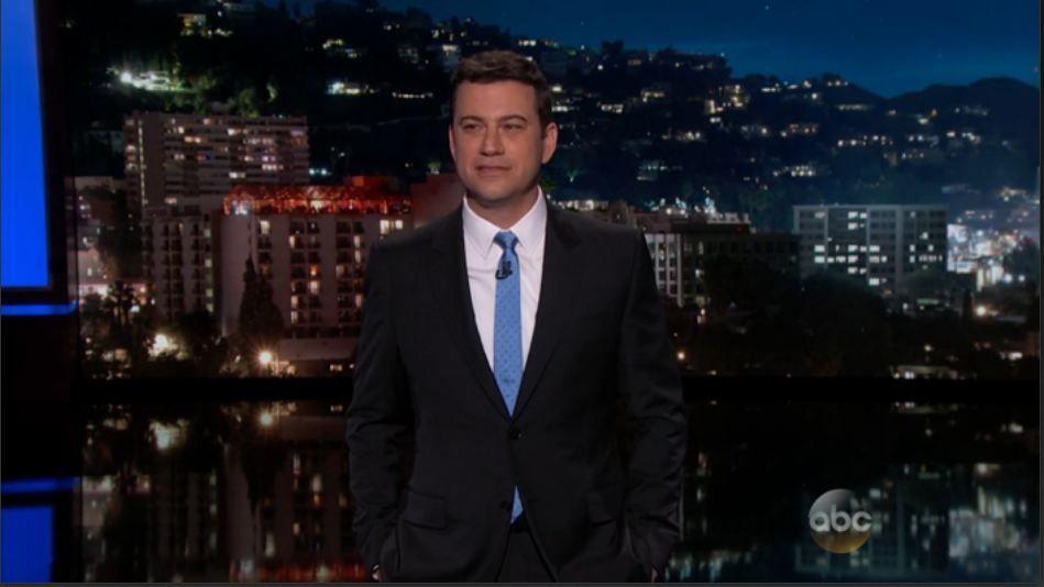 Jimmy Kimmel Black suit white shirt light blue February ...
