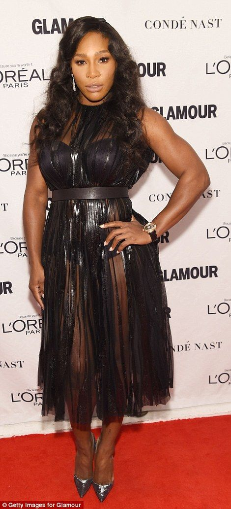 Vamping it up! Serena Williams showed off her athletic physique in a PVC style corset whic...