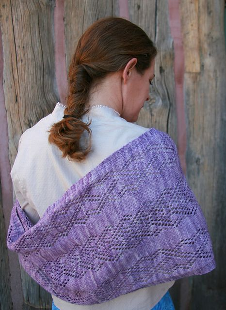 Ravelry: Wealhtheow Wrap pattern by Karen Robinson: This rhomboid shawl contains a rectangular center that can be customized to your desired size with each end narrowing to a point. You can wear this as a wrap around your shoulders or as a scarf around your neck. Knit with fingering weight yarn, this wrap is light enough for spring.