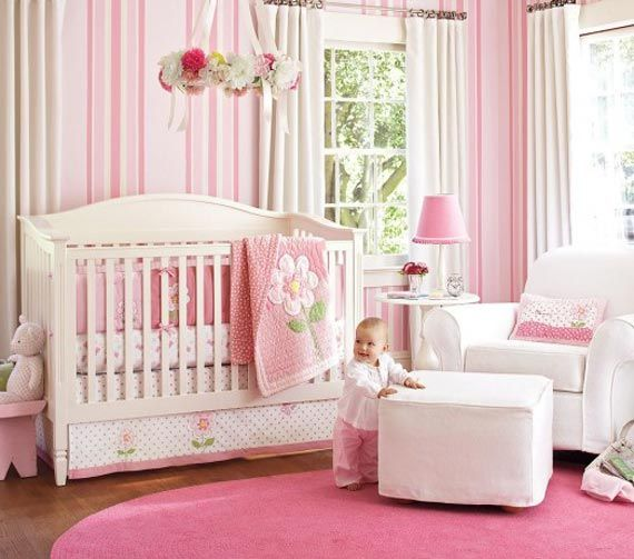 """I love love love the wallpaper. A lot of things I choose are """"grow with me"""" types of decor and this beautiful pink striped wallpaper fits the bill."""