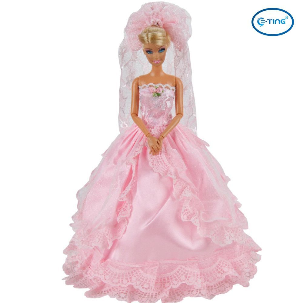 This Barbie doll clothes includes a lace gown and a veil, perfectly ...